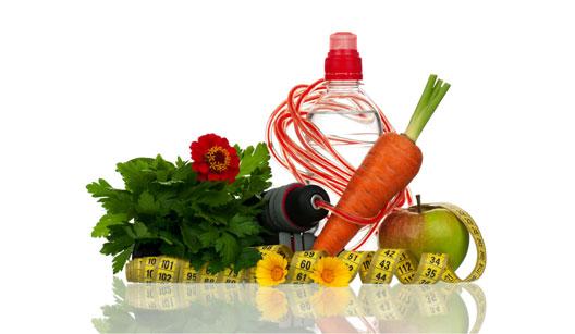 Cenoura, maça, verdura, corda e fita métrica